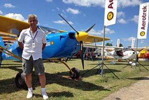 Aerotrek importer boss Rob Rollison stands in front of his EAA AirVenture Oshkosh 2016 display.