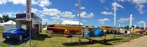 In this panorama shot, you see the entire Aerotrek display. To the left is a handsome trailer that can house an Aerotrek under which the owner drives his late-model Corvette. Nice!