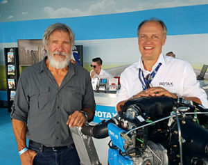 Actor Harrison Ford poses with Rotax Aircraft Engine manager, Christian Mundigler at Oshkosh. photo courtesy Christian Mundigler